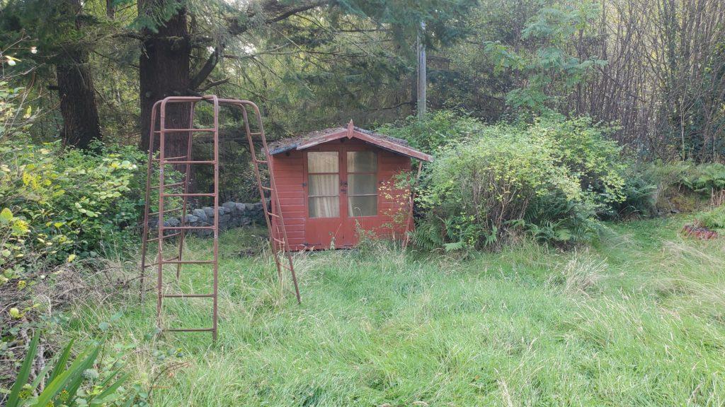 small shack in garden